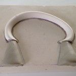 Coffee Jug Handle model in base set for mould with seam line filled & clay feeds