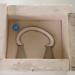 Handle mould first side framed & ready to be run (one plastic natch is stuck in place with clay)